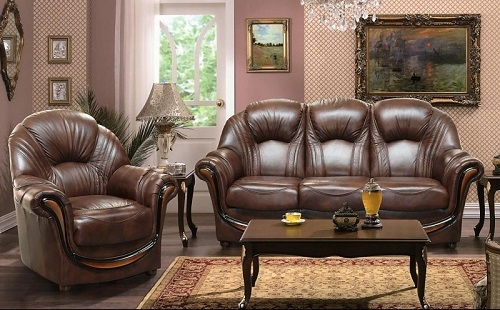 кабинет обставленный кожаной мебелью